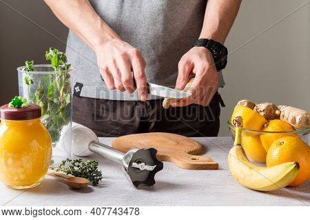 Cut With A Knife On The Fly. Cut Off A Piece Of Vegetable. Cut With A Kitchen Knife. A Man Holds A K