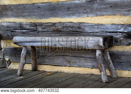 Bench Seat, Built Of A Hewn Log, Sits On The Porch Of The Stage Coach Stop Cabin In Collierville, Te