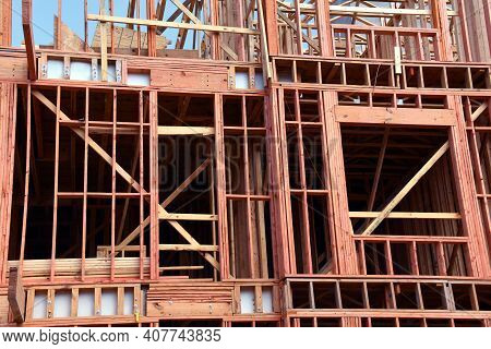 Framing On A Building Is In Progress In Memphis, Tennessee.  Boards And Two-by-fours Crisscross To M