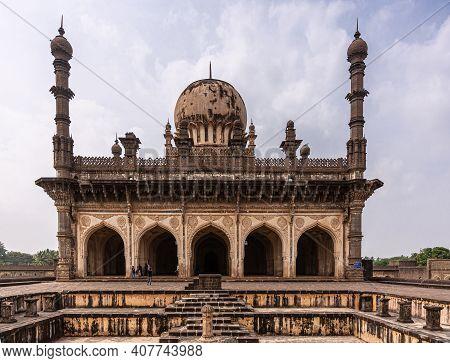 Vijayapura, Karnataka, India - November 8, 2013: Ibrahim Rauza  Mosque From Behind Dry Pool Under Bl