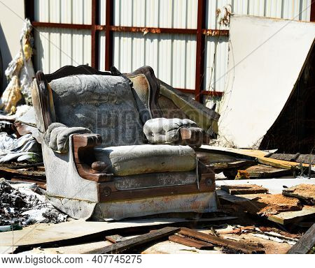 Storm Took Out The Walls, Roof And Floor Of This Building.  Easy Chair Sits Exposed To The Elements