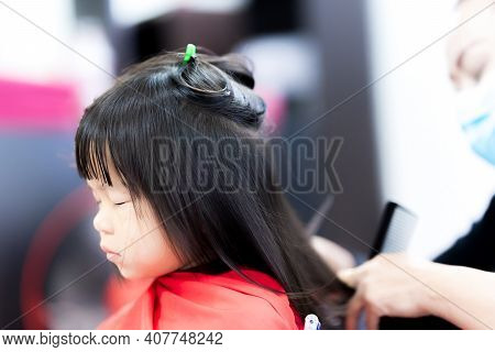 Cute Girl Closed Her Eyes And Covered Veil On Body In Barber Shop. Child Underwent Hairstyling For T
