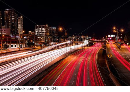 Long Exposure Over A Highway In The Dark Of Night During Rush Hour. Cityscape Background.