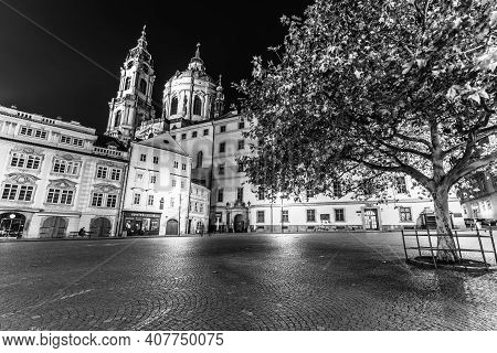 Prague, Czech Republic - December 21, 2020: Lesser Town In Prague By Night. Cobbled Street And Illum