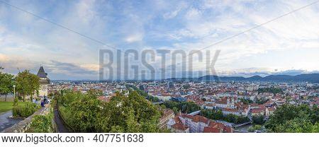 Graz, Austria 14.08.2020 Cityscape Of Graz And The Clock Tower (grazer Uhrturm), Famous Tourist Attr