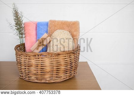 Aromatherapy Spa Set For Bath Or Shower Concept. Saop, Towel, Luffa Bath With Flowers In Wicker Bask