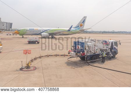 Bangkok, Thailand- January 24 2021 : Airline Crew Refueling Of The Aircraft At Don Mueang Airport (d