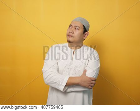 Asian Muslim Man Shows Thinking Contemplating Expression. Looking For Solution Of A Problem. Close U