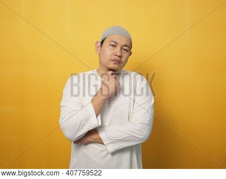 Portrait Of Cynical Asian Muslim Man With Suspicious Expression Looking And Starring, Mistrust Misdo