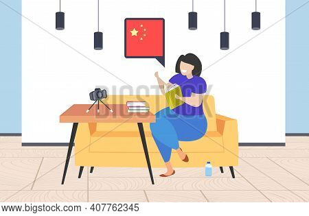 Woman Blogger Holding Dictionary Vocabulary Chat Bubble With China Flag Teacher Recording Video With