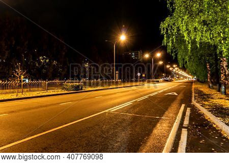Artistic Photo Of A Night City. Easy Blur, Unrealistic Colors, Pasteurization Effect