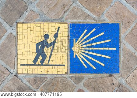 Camino de Santiago pilgrimage sign on the pavement in Chartres, France.