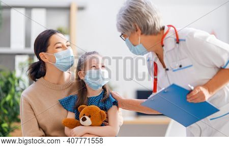Doctor, child and mother wearing facemasks during coronavirus and flu outbreak. Virus protection. COVID-2019. Taking on masks.