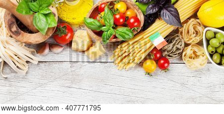 Various Italian food. Pasta ingredients on wooden table. Top view flat lay
