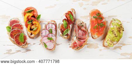 Brushetta traditional spanish tapas. Appetizers italian antipasti snacks set. Top view flat lay