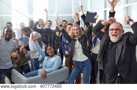 Happy multi ethnic co-workers celebrating a victory