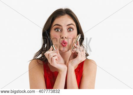 Surprised beautiful caucasian girl posing with mascara isolated over white background