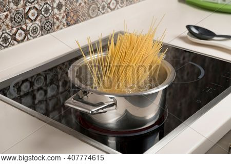 Spaghetti pasta boiling in cooking pan