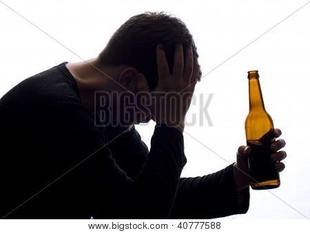 Troubled Man With A Bottle Of Beer