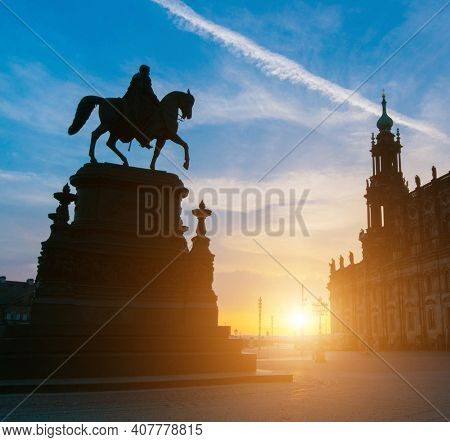 Statue of the saxon King Johann in front of the opera house Semperoper on the Theatre square in Dresden. At sunrise time