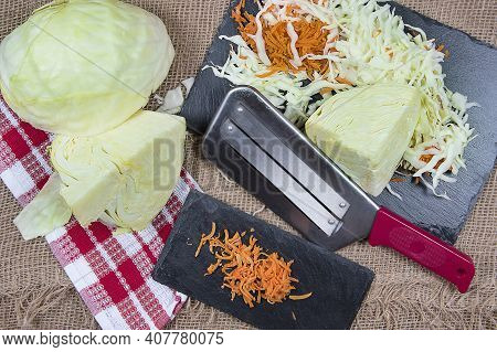Сhopping Knife And Chopped Cabbage On Cutting Board, Burlap Background, Top View