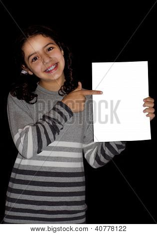 Child pointing at white card