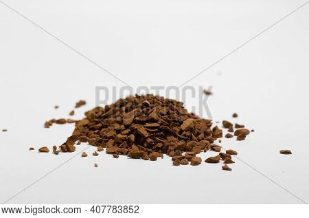 Close-up Of Granules Of Granulated Instant Coffee, White Background