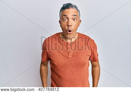 Handsome middle age mature man wearing casual clothes scared and amazed with open mouth for surprise, disbelief face