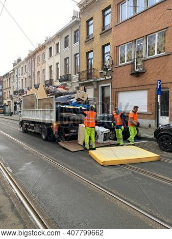 Brussels, Laeken, Belgium, Febuary 9, 2021 -  Men and truck garbage collector cleanning the city