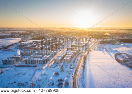 Aerial landscape of Pruszcz Gdanski covered with fresh snow at sunrise. Poland