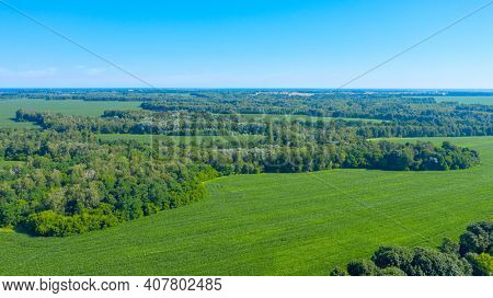 Beautiful summer landscape of a green valley. Aerial drone view over spring plain landscape.