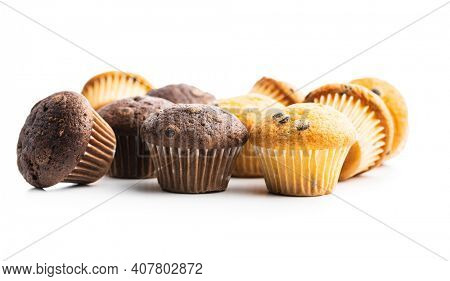 Chocolate and vanilla muffins. Sweet cupcakes isolated on white background.