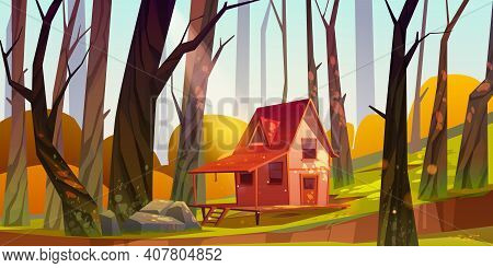 Wooden Stilt House In Autumn Forest. Old Shack With Terrace On Piles In Sunny Wood With Fall Bare Tr
