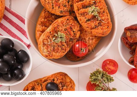 Toasted Bread With Tomato And Oregano On White Dish.