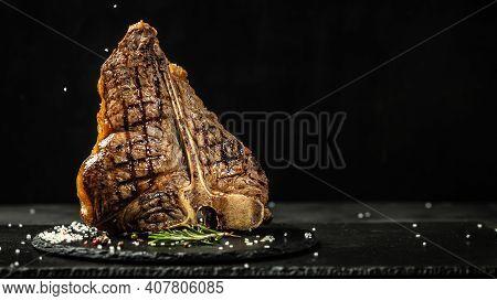 The T-bone Or Porterhouse Steak Of Beef Cut From The Short Loin. Steakst-shaped Bone With Meat On Ea