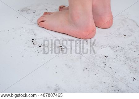 The Soil In The Bathroom From Dirty Children's Feet.