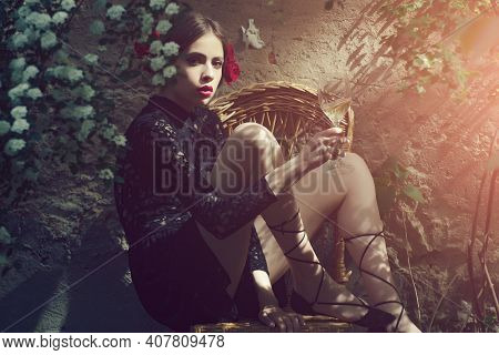 Wine Glass In Hand Of Young Woman Or Fashion Model Sitting On Chair In Sunny Yard On Outdoor Wall. E