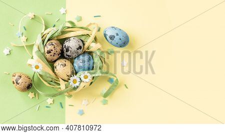 Easter Eggs In The Stylish Nest On Pastel Yellow Green Background. Copy Space