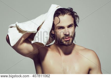 Morning Man With Muscular Wet Body Hold Towel In Bath Or Shower After Washing, Hygiene And Skincare,