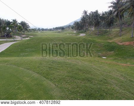 View Of The Golf Course On The Background Of The Mountains