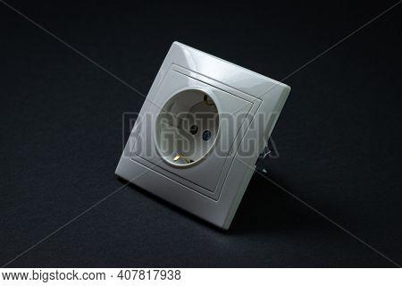 White Socket On A Black Background. Flush-mounted White Socket.