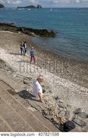 Cancale, France - September 15, 2018: People Eating Oysters Bought On The Seafront At Cancale, Britt