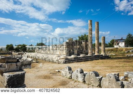 Ruins columns of Temple of Leto in Letoon Ancient City in village Kumluova, Turkey. Sunny day, Greek culture temple ruins