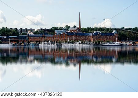 Stockholm, Sweden - August 8, 2019: Scenic View Of The Bay Of Stockholm With Building And Ships Refl