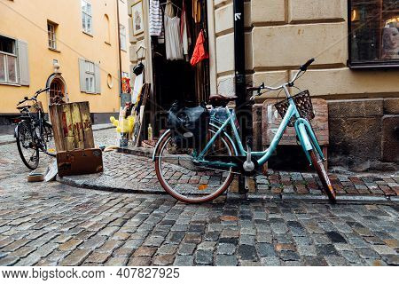 Stockholm, Sweden - August 8, 2019: Bicycles Parked In Front Of Vintage Fashion Store In Gamla Stan