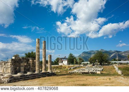 Ruins columns of Temple of Leto in Letoon Ancient City in village Kumluova, Turkey. Sunny day, Greek architecture temple ruins