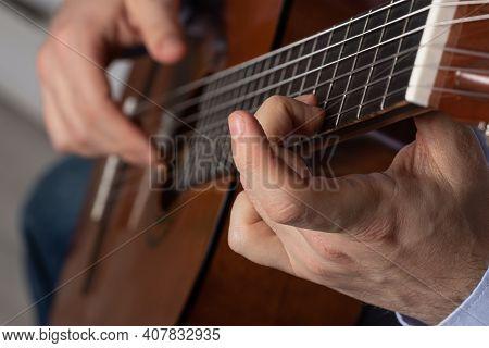 Man Shows Guitar Chords. Playing Guitar Close Up