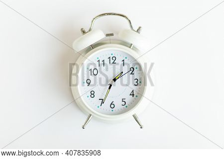 Creative Flat Lay Vintage Clock On White Color Office Table Top View Background Concept Retro Clock