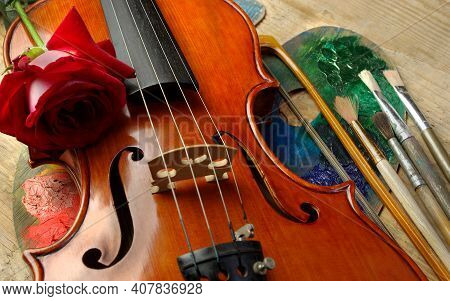 Violin, Red Rose, Palette And Brushes. Close Up