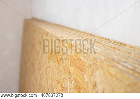 Chipboard Sheets In The Room Of The House Where The Renovation Is In Progress.